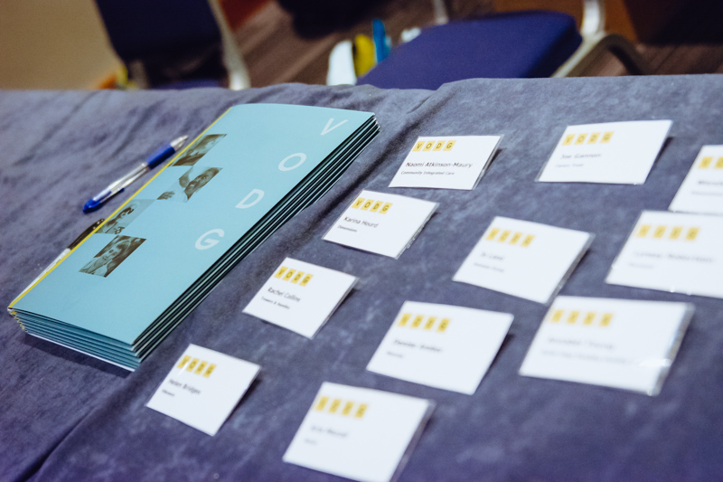 Name badges and a brochure at a VODG event